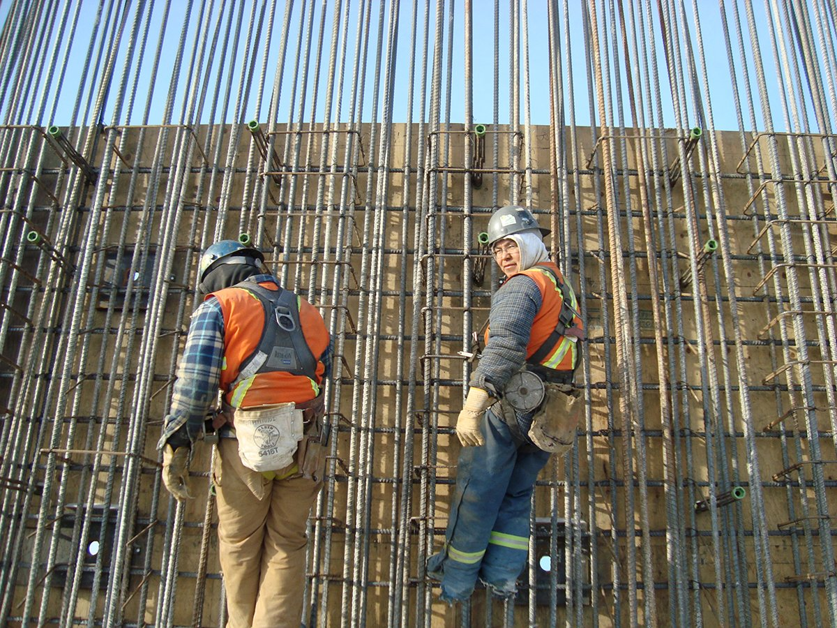 Couple guys doing rebar work building mine